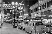 1302-08-07 looking west on SW Morrison from Broadway. Miracle Mile Christmas displays. December, 1957