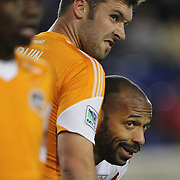 Thierry Henry, (right), New York Red Bulls, is defended by Will Bruin, Houston Dynamo as they wait for a corner kick  during the New York Red Bulls V Houston Dynamo, Major League Soccer regular season match at Red Bull Arena, Harrison, New Jersey. USA. 23rd April 2014. Photo Tim Clayton