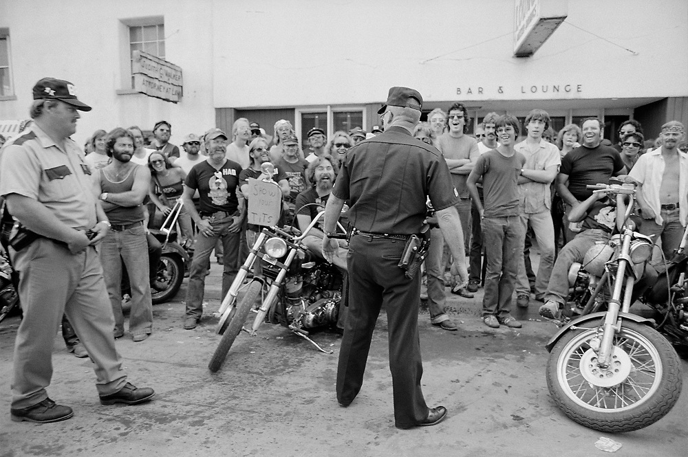 Harass the Police, Sturgis, SD 1980<br /> <br /> Limited Edition Print from an edition of 50. Photo ©1980 Michael Lichter.<br /> <br /> Description: All for fun, fun for all. Can we laugh together and laugh at each other anymore?