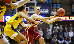 Feb 2, 2019; Morgantown, WV, USA; Oklahoma Sooners forward Brady Manek (35) passes the ball during the first half against the West Virginia Mountaineers at WVU Coliseum. Mandatory Credit: Ben Queen-USA TODAY Sports
