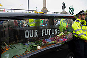A hearse with a coffin inside parked  in Trafalgar Square on 7th October, 2019 in London, Untited Kingdom. Extinction Rebellion plan to occupy 12 sites situated around key Government locations around Westminster for two weeks to protest against climate change.