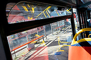 Seen through a London bus window is the empty seating  area of a bus shelter at Waterloo in south London, during the third lockdown of the Coronavirus pandemic, on 29th March 2021, in London, England.