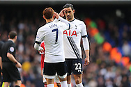 Nacer Chadli of Tottenham Hotspur celebrates with Son Heung-Min of Tottenham Hotspur after the final whistle.Barclays Premier league match, Tottenham Hotspur v Manchester Utd at White Hart Lane in London on Sunday 10th April 2016.<br /> pic by John Patrick Fletcher, Andrew Orchard sports photography.