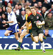 Chris Ashton of England runs in his second try during the Investec series international between England and Australia at Twickenham, London, on Saturday 13th November 2010. (Photo by Andrew Tobin/SLIK images)