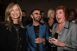 """© under license to London News Pictures. LONDON, 19/05/2011. Cilla Black, right, with Barbara Bach and Beatle Ringo Starr. Opening of the Tommy Nutter Exhibition """"Rebel on the Row"""" at the Fashion and Textile Museum, London. Photo credit should read BETTINA STRENSKE/LNP"""