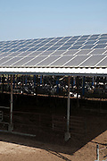 Electricity converting solar panels on a roof of a cowshed. With the reduction on cost of ownership of these panels, combined with the rise in the cost of electricity have created a positive return on investment on solar electricity. The surplus electricity is sold to the electric company for distribution