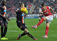 Emmanuel Ledesma of Rotherham United shoots for goal against Blackpool during the Sky Bet Championship match at the New York Stadium, Rotherham<br /> Picture by Graham Crowther/Focus Images Ltd +44 7763 140036<br /> 29/11/2014