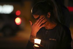 LAS VEGAS, Oct. 3, 2017  A woman attends a candle light vigil to mourn the victims of a mass shooting in Las Vegas, the United States, on Oct. 2, 2017. At least 59 people were killed and 527 others wounded after a gunman opened fire Sunday on a concert in Las Vegas in the U.S. state of Nevada, the deadliest mass shooting in modern U.S. history.  zy) (Credit Image: © Wang Ying/Xinhua via ZUMA Wire)