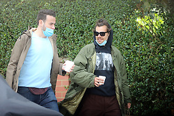 EXCLUSIVE: IN mask, hoodie and shades, this famous singer was only heading in One Direction to get his daily coffee fix. The former boyband member pulled his long hair into a man bun and clutched a coffee while out with friend and producer Ben Winston. In a bid to stop himself being recognised he was also wearing a hoodie and shades. Harry is back in the UK after being stuck in California at the beginning of the lockdown. 29 Jun 2020 Pictured: Harry Styles Ben Winston. Photo credit: MEGA TheMegaAgency.com +1 888 505 6342