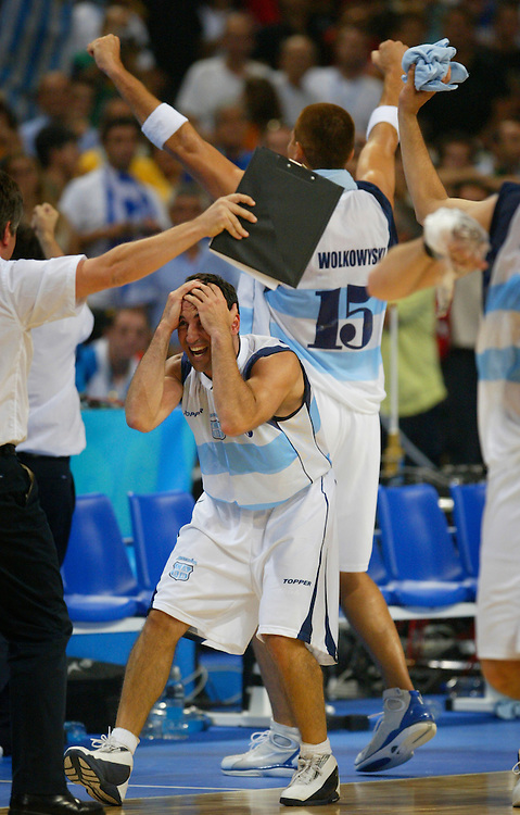 Alejandro Ariel Montecchia of the Argentina men's basketball squad, foreground, celebrates at the buzzer after the 89-81 victory  over the United States during the semifinal match at the 2004 Summer Olympic Games at  in Athens, Greece. The victory put Argentina in the gold medal game.