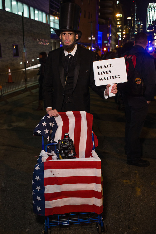 "New York, NY - 31 October 2016. A man in a stovepipe hat and costumed as Abraham Lincoln holds a sign that reads ""Back lives matter."" The sign also flipped to read ""Republicans for Hillary."""