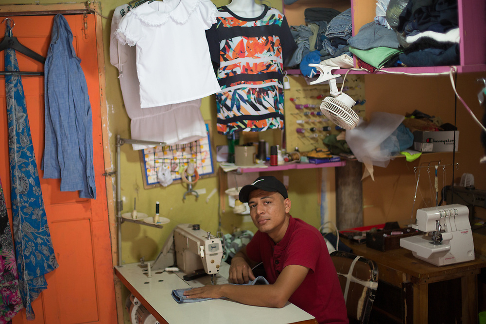 Carlos Andrés Enriquez Hernández, 23, Tailor, Barrio La Soledad, Juticalpa, Olancho<br /> <br /> I was in four iceboxes in the US, about three days in each. The icebox is a room where they put you with very cold air conditioning, the aim of it is to freeze you, to make you more likely to sign the form so that they can send you straight home. It really is freezing, you are on the floor, there's no bedding, you don't have enough clothes, your teeth chatter and you feel like you are going to die.<br /> <br /> I was deported after about 20 days. I met someone here in Juticalpa who told me about the LWF.<br /> <br /> I left my place because of danger. What does danger mean? Ha! Danger here is not an abstract concept. My whole family was threatened by a gang. Threats against your life are part of controlling you, subjecting you. My whole family had to leave. People who don't take notice of threats like that are simply killed. We've lost a lot of friends and neighbours, they disappeared. The gang here use a tourniquet on your neck, that's their signature.<br /> <br /> When I came back, I moved. I had nothing, lost everything. <br /> <br /> The LWF helped me get back on my feet. I make school uniforms, I make adjustments to clothes, I make suits and rent them for weddings. I have dreams of getting bigger to start making clothes that people here want. I have no plan to go back to the US. <br /> <br /> With skills here, and a helping hand to get on your feet, and plenty of hard work, you can make it here, you can survive.<br /> <br /> LWF's programme for deported and returned migrants is supported by ELCA.