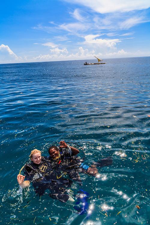 Scuba divers joy after successful diving in the Indian Ocean in Kenya.