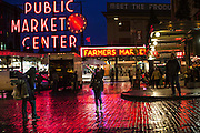 A wet and gloomy commute greeted workaday Seattle for the evening commute home, shown here at the Pike Place Market downtown. (Dean Rutz / The Seattle Times)