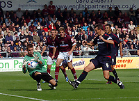 Photo: Kevin Poolman.<br />Northampton Town v Nottingham Forest. Coca Cola League 1. 12/08/2006. Forest's Ian Breckin can't get to the ball before Northampton keeper Mark Bunn.