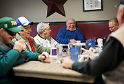 MONTICELLO, IA – JANUARY 6: Jerry Retzlaff, center, and a table of diners at Darrell's share a laugh while discussing politics over breakfast on January 6, 2017.