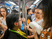 12 DECEMBER 2013 - BANGKOK, THAILAND:   Commuters on the Sukhumvit line of the BTS Skytrain in Bangkok.    PHOTO BY JACK KURTZ