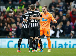 Goalkeeper Jak Alnwick of Newcastle United, in his first Premier League appearance, celebrates with Fabricio Coloccini and Paul Dummett after Newcastle win 2-1 to inflict a first defeat in all competitions this season on Chelsea - Photo mandatory by-line: Rogan Thomson/JMP - 07966 386802 -06/12/2014 - SPORT - FOOTBALL - Newcastle, England - St James' Park - Newcastle United v Chelsea - Barclays Premier League.