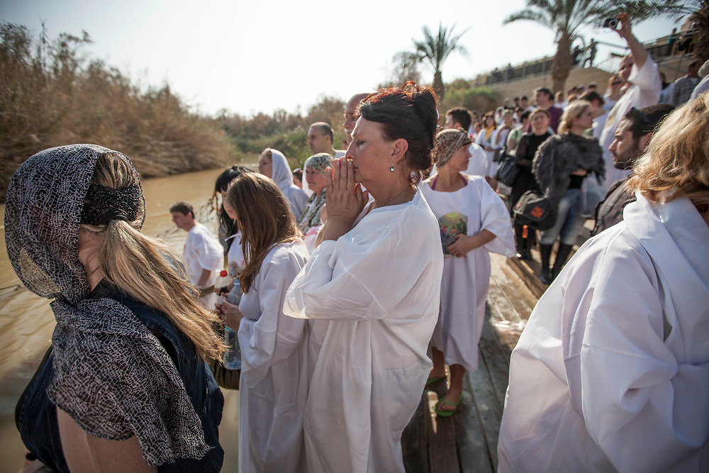 "Jan 18, 2014 - Jerico, West Bank - Christian Orthodox pilgrims perform a baptism ceremony during the day of the Epiphany at the ""Qasr el Yahud"" baptism site in the Jordan River Valley, near the West Bank city of Jerico.The Epiphany celebrates the baptism of Jesus, which belived to be in this same location."