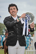 Overall Equitrek CCI*** winner, Yoshiaki Oiwa (JPN) lifts the winner's plate/trophy after the final show jumping round on day four of Bramham International Horse Trials 2017 at  at Bramham Park, Bramham, United Kingdom on 11 June 2017. Photo by Mark P Doherty.