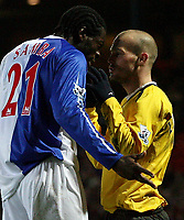 Photo: Paul Thomas.<br /> Blackburn Rovers v Arsenal. The FA Cup. 28/02/2007.<br /> <br /> Arsenal's Freddy Ljundberg (R) tries to tell Christopher Samba what the ball looks like.