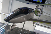 Airbus exhibition stand showing an E-Fan 4.0 at the Farnborough Air Show, England. The Airbus E-Fan is a prototype electric aircraft being developed by Airbus Group. The aircraft uses on-board lithium batteries to power the two electric engines and can carry two passengers. The E-Fan is an all-electric twin-engined low-wing monoplane of composite structure. It has a T-tail and a retractable tandem landing gear with outrigger wheels. The two engines are mounted either side of the rear fuselage.