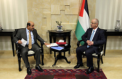 October 7, 2018 - Ramallah, West Bank, Palestinian Territory - Palestinian Prime Minister Rami Hamdallah receives the Annual Report of the Public Staff's Office (2016-2017), in the West Bank city of Ramallah on October 7, 2018  (Credit Image: © Prime Minister Office/APA Images via ZUMA Wire)