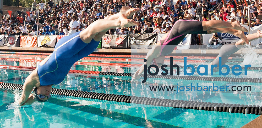 West Ranch's Sophia Morici and San Marocs' Olivia Smith compete in the girls 100-yard butterfly consolation during the CIF-SS Division 1 Swimming Finals at Riverside City College on Saturday.