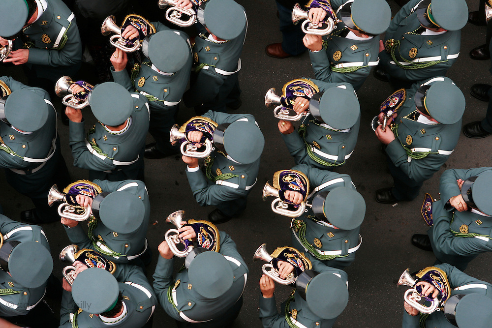 """Sevilla, Spain. April 12th 2006..La Guardia Civil plays music following a """"paso"""" during the processions of the Holy Week."""