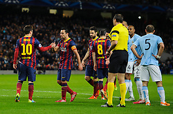 Barcelona Midfielder Lionel Messi (ARG) is congratulated by Midfielder Xavi (ESP) after winning a penalty as referee Jonas Eriksson (SWE) deals with angry Man City players after sending off Defender Martin Demichelis (ARG) - Photo mandatory by-line: Rogan Thomson/JMP - Tel: 07966 386802 - 18/02/2014 - SPORT - FOOTBALL - Etihad Stadium, Manchester - Manchester City v Barcelona - UEFA Champions League, Round of 16, First leg.
