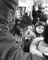 """""""Fuck Trump"""" as women, families, and girls wait patiently on a crowded Washington Metro train on the way to the Women's March on Washington, D.C."""