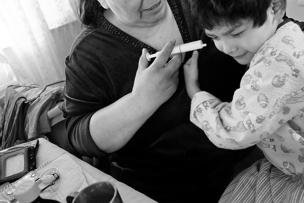 Kevin's grandmother Teresa tries to give him the medicine which keeps his illness at bay.  The task can be simple or excruciating depending on his mood.  June 30, 2008.