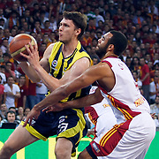 Galatasaray's Joshua Ian SHIPP (R) and Fenerbahce Ulker's Marko TOMAS (L) during their Turkish Basketball league Play Off Final Sixth leg match Galatasaray between Fenerbahce Ulker at the Abdi Ipekci Arena in Istanbul Turkey on Friday 17 June 2011. Photo by TURKPIX