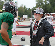Lindenwood head football coach Dale Carlson shares a laugh with QB Darrien Boone during practice.
