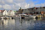 Waterside buildings and boats city centre, Vagen harbour, Bryggen area, Bergen, Norway