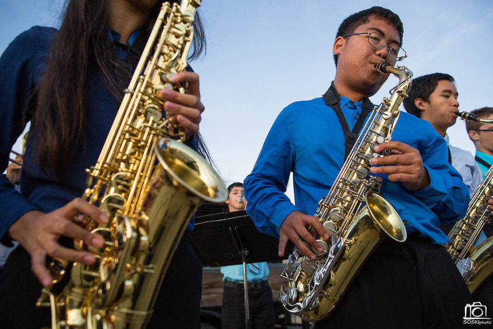 Alexander Sanchez plays the Alto Saxophone with the Milpitas High School Band during the Milpitas Unified School District and San Jose Evergreen Community College District Community College Extension Ground Breaking Ceremony near Russell Middle School in Milpitas, California, on November 17, 2015. (Stan Olszewski/SOSKIphoto)