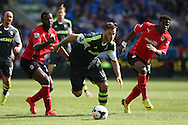 Marko Arnautovic of Stoke city  bursts between Kevin Theophile-Catherine and Wilfried Zaha of Cardiff. Barclays Premier league match, Cardiff city  v Stoke city at the Cardiff city stadium in Cardiff, South Wales on Saturday 19th April 2014. pic by Mark Hawkins, Andrew Orchard sports photography,