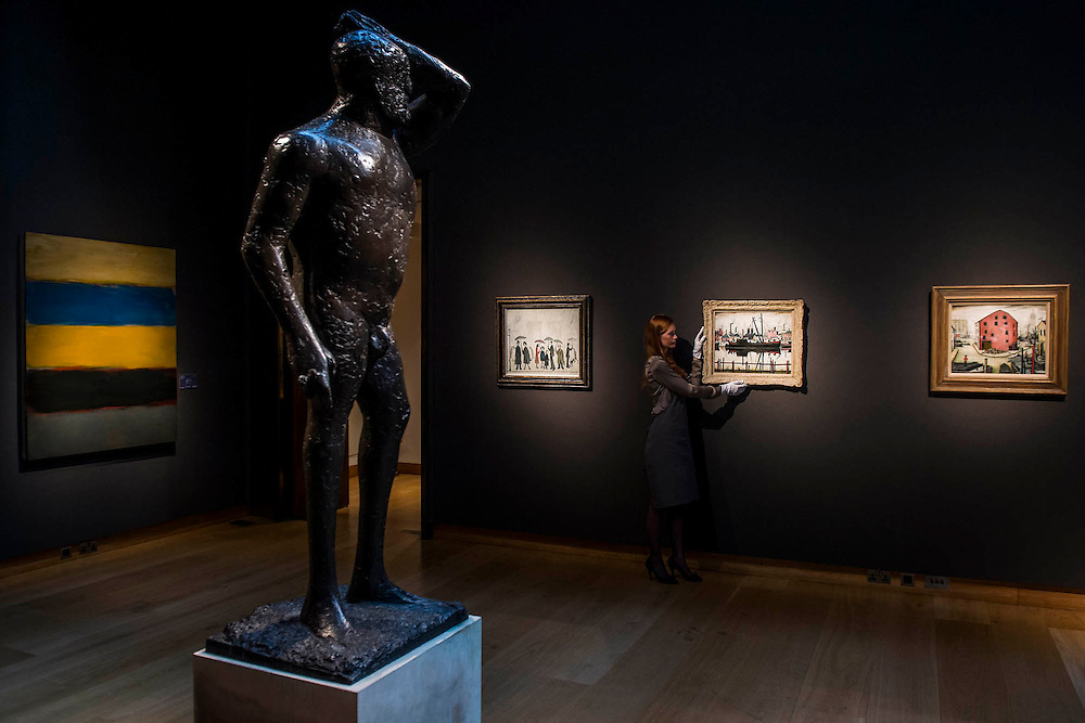 L.S. Lowry, led by Coal Barge and others, with First man by Dame Elisabeth Fink in the foreground - Christie's Modern British and Irish Art Sale which will take place on 19 November 2014. Featuring 35 lots, the auction includes  examples of 20th century British sculpture and painting, such as: John Duncan Fergusson's Poise (estimate: £80,000-120,000); six paintings by L.S. Lowry, led by Coal Barge (estimate: £700,000-1,000,000);  Euan Uglow's masterpiece entitled Three In One (estimate: £500,000-800,000; Figure (Sunion) by Dame Barbara Hepworth (estimate: £600,000-800,000); and sculpture by leading artists of the genre including Henry Moore, Lynn Chadwick, Dame Elisabeth Frink, and Naum Gabo.