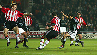 Photo. Andrew Unwin.<br /> Southampton v Newcastle United, FA Cup Third Round, Friends Provident St Marys Stadium, Southampton 03/01/2004.<br /> Newcastle's Kieron Dyer strikes home his team's first goal.