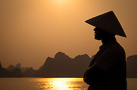 HA LONG BAY, VIETNAM - CIRCA SEPTEMBER 2014:  Profile of Vietnamese man in Halong Bay