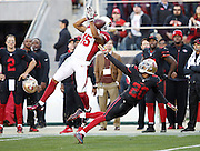 Arizona Cardinals wide receiver Michael Floyd (15) leaps while trying to catch a fourth quarter pass broken up by San Francisco 49ers cornerback Kenneth Acker (20) who gets flagged for a pass interference penalty that gives the Cardinals a first down at the 49ers 32 yard line during the 2015 week 12 regular season NFL football game against the San Francisco 49ers on Sunday, Nov. 29, 2015 in Santa Clara, Calif. The Cardinals won the game 19-13. (©Paul Anthony Spinelli)
