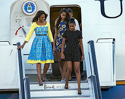 © Licensed to London News Pictures. 15/06/2015. Stansted, UK. First Lady MICHELLE OBAMA arrives in the UK at Stansted Airport accompanied by her daughters Malia and Sasha for the start of a three day visit to the UK. During the visit the First Lady and her family will meet with students at Mulberrry School for Girls and have Tea with Prime Minister David Cameron and Samantha Cameron. Photo credit: Ben Cawthra/LNP