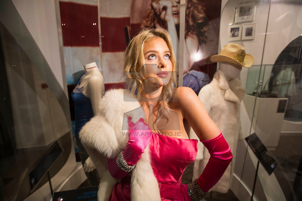"""18/08/2014 Model, Julia Mielcarek is pictured wearing Madonna's iconic """"Material Girl"""" dress and jewellery, which were all worn in her """"Material Girl"""" video. The outfit is on display as part of an exclusive Madonna exhibition at Newbridge Silverware's Museum of Style Icons from now until 15th September. See www.newbridgesilverware.com for more information. Picture: Andres Poveda"""