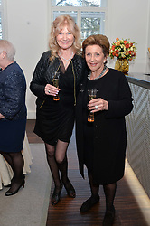 Left to right, DEBBIE MOORE and PATSY BLOOM at a dinner in honour of Veuve Clicquot Business Woman Award UK Previous Winners held at Moet Hennessy, 18 Grosvenor Gardens, London on 8th April 2014.