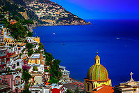 """""""Cross and Dome of Santa Maria Assunta in Positano""""…<br /> <br /> I never ventured to attempt many photos in the hot daylight sun of Italy; however, as the sun dropped down behind the cliffs of Positano in early evening…the lighting on the picturesque Amalfi village brought out the depth of color and highlighted the plush vegetation.  Around 5:00pm, I positioned the camera at the edge of the opposing cliff to frame this image allowing the colors to derive their true spectrum of light and power.  The focal point of most views of Positano is the church of Santa Maria Assunta.  The colorful dome is made of majolica tiles which are very prominent on the Amalfi Coast, and the church contains a thirteenth-century Byzantine icon of the legendary Black Madonna."""