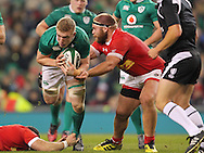 Dan Leavy of Ireland is tackled by Jake Ilnicki of Canada during the 2016 Guinness Series  autumn international rugby match, Ireland v Canada at the Aviva Stadium in Dublin, Ireland on Saturday 12th November 2016.<br /> pic by  John Halas, Andrew Orchard sports photography.