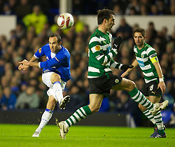LIVERPOOL, ENGLAND - Tuesday, February 16, 2010: Everton's Landon Donovan shoots against Sporting Clube de Portugal during the UEFA Europa League Round of 32 1st Leg match at Goodison Park. (Photo by: David Rawcliffe/Propaganda)