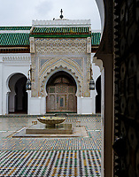 FEZ, MOROCCO - CIRCA MAY 2018:  Detail of door at the Al-Attarine Madrasa in Fez. The courtyard of this small Marinid madrasa is a dazzling example of intricate Islamic architecture.
