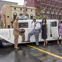In front of the Majestic Metro Theater members of the SGR Rhyme Family, Big Nate-The Hit Man, left, Son of Jesse (D. Smith), Alkendria-Lullaby, Tragedy-Queen of the South and G. Anderson all pose with a 1928 Essex Ford Limousine.