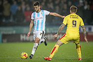 Tommy Smith (Huddersfield Town) passes the ball down the wing - around Danny Ward during the Sky Bet Championship match between Huddersfield Town and Rotherham United at the John Smiths Stadium, Huddersfield, England on 15 December 2015. Photo by Mark P Doherty.